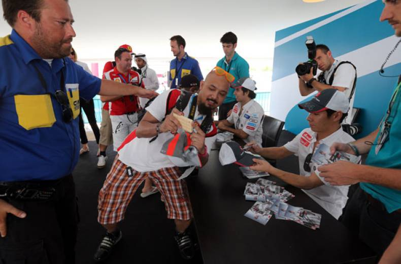 racing-enthusiasts-wait-in-line-to-get-the-autographs-of-sergio-perez