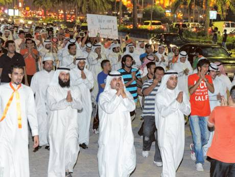 Opposition supporters block a major road in Kuwait City