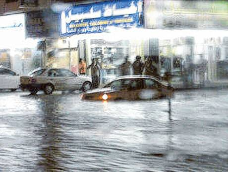 Floodwater partially submerges a car in Fujairah