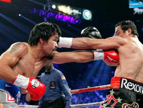 Juan Manuel Marquez celebrates his 6th round knock out victory