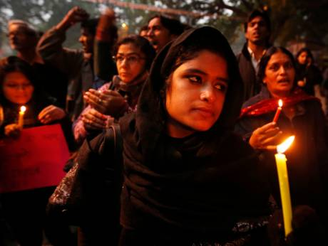 People light candles for a gang-rape victim in India