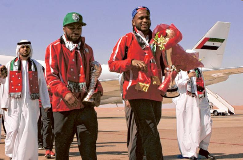 uae-players-esmail-mattar-left-and-ali-khaseef-right-walk-out-of-the-team-aircraft