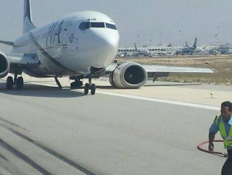A PIA plane at Muscat airport