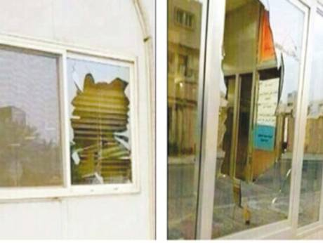 Shattered glass windows of the Al Baharna mosque