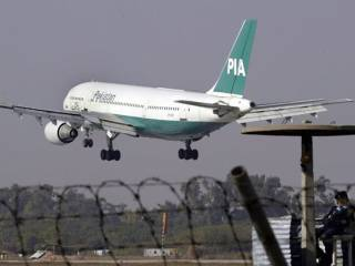 PIA plane flies with passengers standing