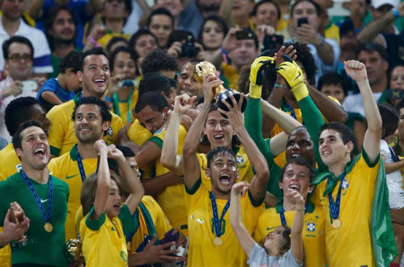 brazil-s-neymar-c-hoists-the-trophy-as-he-celebrates-on-the-podium-with-his-teammates