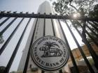 Rupee recovers from record low, closes at 68.84