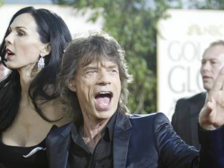 British musician and actor Mick Jagger and his girlfriend L'Wren Scott