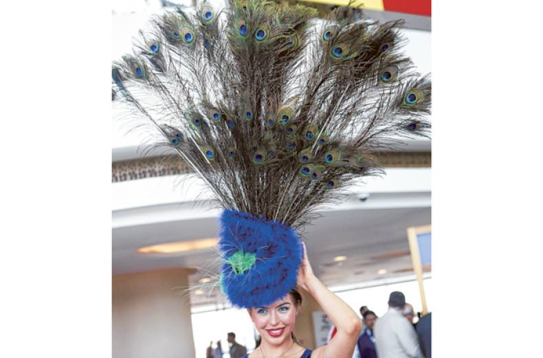 a-race-enthusiast-coming-with-an-interesting-hat-at-dubai-world-cup