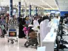 Passengers at counters at Terminal 2 of Dubai International Airport. Airfares are up in line with the annual holiday season ahead of Christmas and New Year.