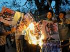 Gutted Indians burn pictures of their idols