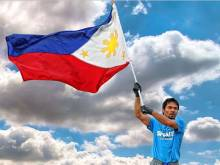 Pacquiao waves his flag for the Philippines