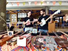 Guitars made from oil cans, cigar boxes