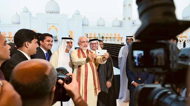 Narendra Modi takes a selfie at the Shaikh Zayed Mosque
