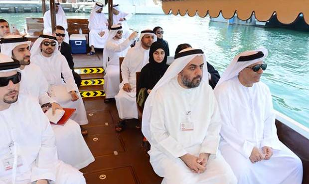 Modern abras shuttle passengers in Dubai Creek