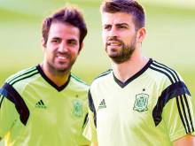 Pique hails Fabregas as he closes on 100 caps