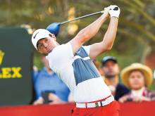 McIlroy in joint lead on dramatic day