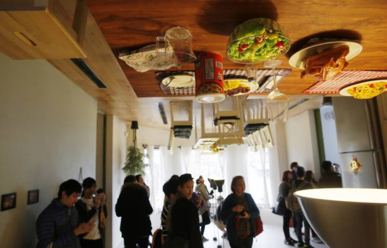 Hundreds flock to see Taipei's upside-down house | GulfNews.com on upside down exercise, upside down snowman, upside down sit-ups, upside down train, upside down ten mean, upside down dogs, upside down photography, upside down christmas,