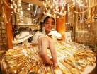 Gold crawls higher as dollar eases