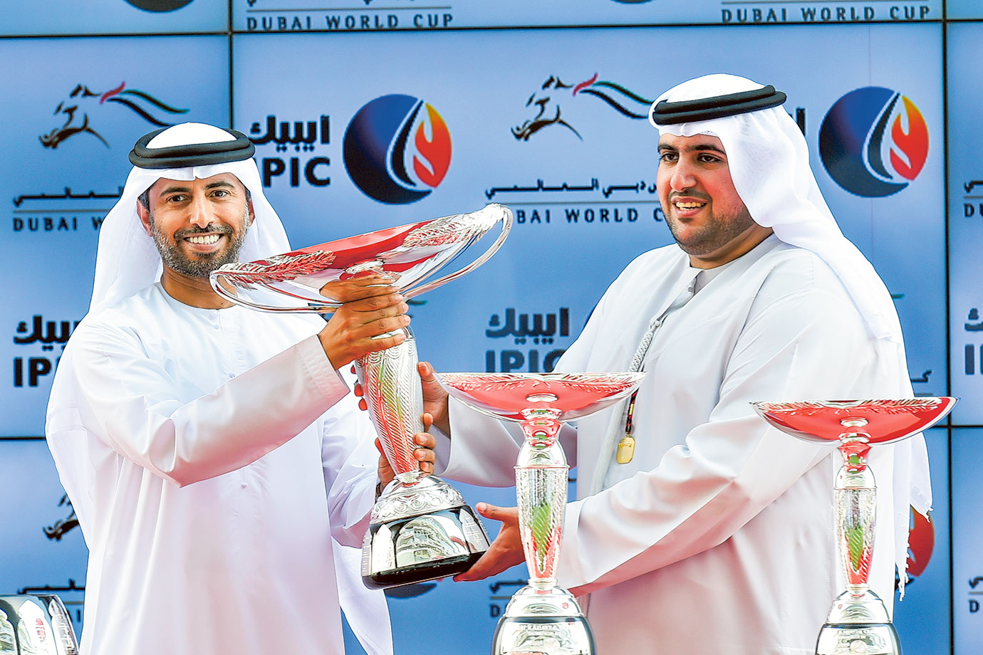 Shaikh Saeed Bin Hamdan Bin Rashid Al Maktoum receives the owner's trophy