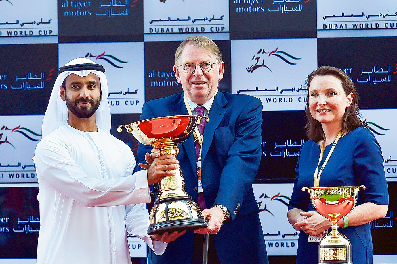 Humaid Ahmad Al Tayer hands over the trophy to Georges Rimaud