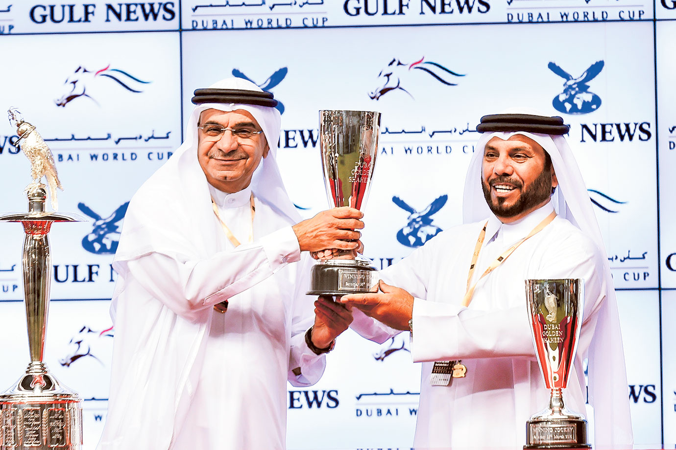 Trainer Musabah Al Muhairi receives the trophy from  Abdul Hamid Ahmad