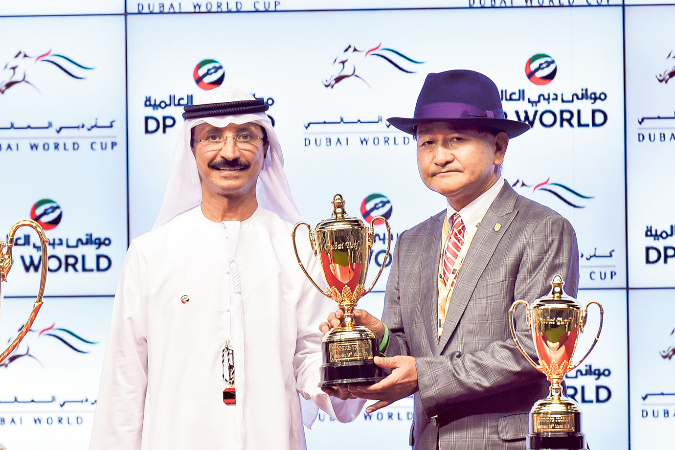 Trainer Yoshito Yahagi  receives the trophy from Sultan Ahmed Bin Sulayem