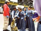 Grade 8 students from Dubai's New Indian Modern School pet Fodo, a search dog from theDubai Police Transport Security Department, at the Mena Transport Congress and Exhibition.