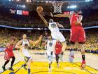 Golden State Warriors guard Ian Clark (21) goes up for a layup against Houston Rockets forward Trevor Ariza (1) during the first half in game five at Oracle Arena on Wednesday.