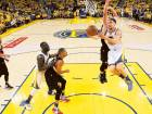 Golden State Warriors guard Klay Thompson (right) shoots against the Portland Trail Blazers during the second half in Game 1 of a second-round NBA basketball play-off series in Oakland, California., Sunday. The Warriors won 118-106.