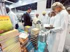 A group of Emirati students read the books at a stall  on the last day of  Abu Dhabi Intl. Book Fair 2016 at ADNEC yesterday.