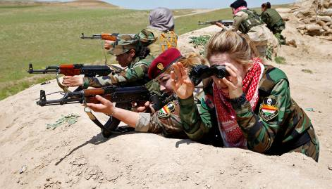 Yazidi women train guns on Daesh