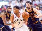 Raptors guard Kyle Lowry (7) controls the ball as Cavaliers forward Kevin Love (0) and guard Kyrie Irving defend during the second half of Eastern Conference finals play-off.