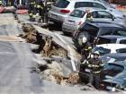 Collapsed road in Florence sinks cars