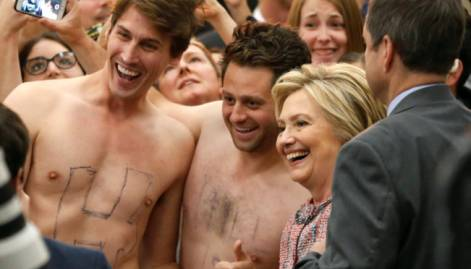Hillary gets distracted by shirtless men