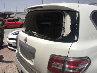 Man held for breaking car windows