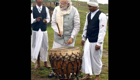 Pictures: Modi plays Khasi drum