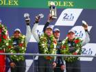 Khalid Al Qubaisi (left) and Patrick Long with Abu Dhabi-Proton Racing team members on the podium at Le Mans.