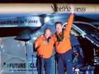Andre Borschberg (right) waves to the crowd next toBertrand Piccard after the Solar Impulse 2 landed at JFK International Airport on June 11.