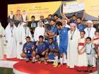 Al Joker team, winners of  the Sixth Shaikh Maktoum Bin Rashid Football Championship trophy with Shaikh Zayed Bin Maktoum Bin Rashid Al Maktoum and Mohammad Saeed Al Merri.