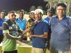 Nasir Aziz, captain of Alubond Tigers, receives the eighth Al Dhaid Ramadan Cup trophy from Mazhar Khan, Honorary Secretary, Sharjah Cricket Council.