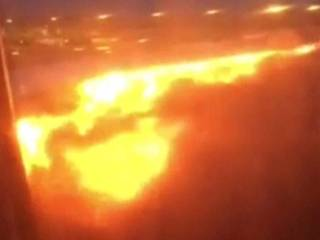 Passenger jet catches fire while landing