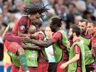 Portugal's Renato Sanches (left) celebrates with his teammates after scoring his side'sequaliser after Poland had taken a 1-0 lead in the second minute of the match.