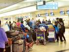 Passengers at Dubai International Airport's check-in hall. For illustrative purposes only