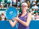 Johanna Konta of Great Britain poses with the trophy after winning the final of the Bank of the West Classic in Stanford.