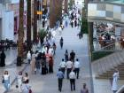 Kuwaitis walk inside the Avenues Mall, the country's largest shopping centre, on July 25, 2016 in Kuwait City as Kuwaitis limit their outdoors activities due the high temperatures recorded in the country.