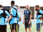 Manchester City team manager Pep Guardiola (second from right) puts his players through arigorous training session on their arrival in Shenzhen after missing the match against Chelsea.