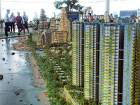 Reclaimed city off Singapore raises eco fears
