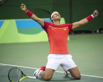 Rio rain forces Nadal to give up mixed doubles