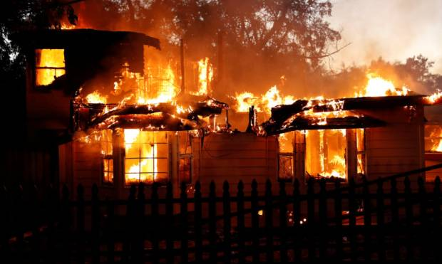 Wildfire rages into California town